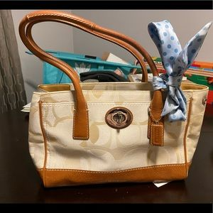 Cream color Coach purse